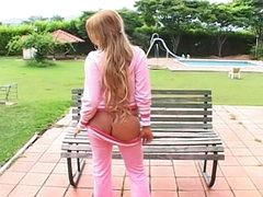 Charming blonde teenie stripping and showing her snatch outdoors